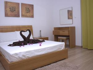 A bed or beds in a room at Private 2 Bedroom Townhouse - Vila Verde Resort