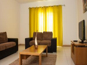 A seating area at Private 2 Bedroom Townhouse - Vila Verde Resort