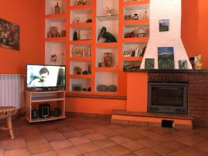 A television and/or entertainment center at Villa Uliveto