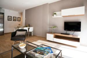 A television and/or entertainment center at Feelathome Mozart Apartments