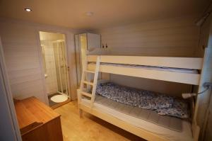 A bunk bed or bunk beds in a room at Apartment Knausen 4
