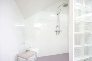 Salle de bains dans l'établissement Maison de Vacances Paradis