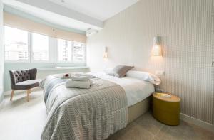 Ein Bett oder Betten in einem Zimmer der Unterkunft America