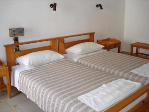 A bed or beds in a room at Popi Hotel Apartments