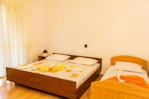 A bed or beds in a room at Apartment Anamaria