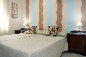A bed or beds in a room at Apartamento Mezquita Guadalquivir