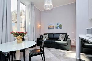 A seating area at Monti Apartments - My Extra Home