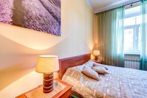 Кровать или кровати в номере Suvorovsky 56