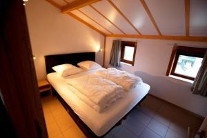Un ou plusieurs lits dans un hébergement de l'établissement Zeepark Haerendycke