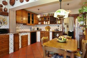 A kitchen or kitchenette at Villa Vittoria