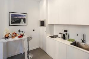 Cuisine ou kitchenette dans l'établissement MY CASA - PAULE