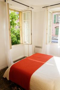 A bed or beds in a room at Acropolis loft Nice Garibaldi