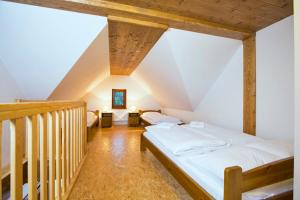 A bed or beds in a room at Apartmány Udatný