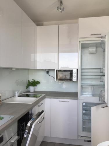 A kitchen or kitchenette at Bursztynowy Green