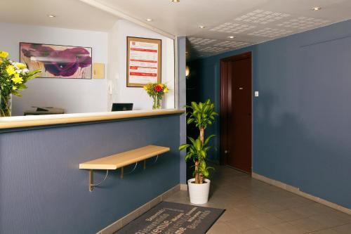 Vstupní hala nebo recepce v ubytování Séjours & Affaires Paris-Nanterre