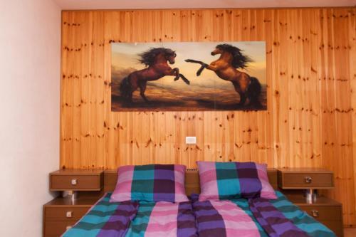 Postelja oz. postelje v sobi nastanitve Apartmaji Mlekuž