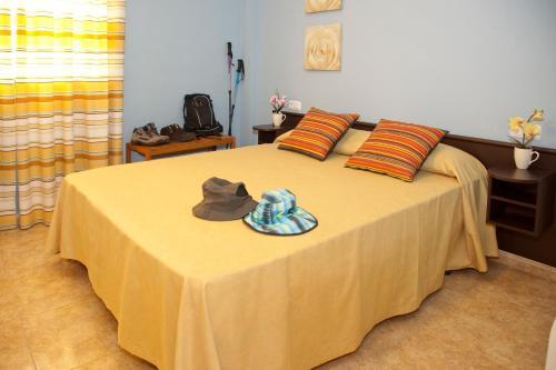 A bed or beds in a room at Apartamentos Campuebla