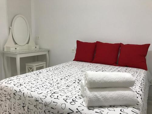 A bed or beds in a room at Smart-Tech Plaza Apartment