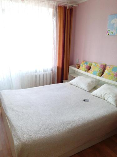 A bed or beds in a room at Apartment On Tatarstan
