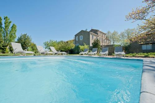 The swimming pool at or near LE MANOIR DE CANET D'AUDE
