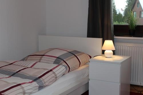 A bed or beds in a room at Gästehaus Fürst