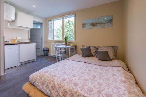 Un ou plusieurs lits dans un hébergement de l'établissement Studio Vent - ANNECY DREAM