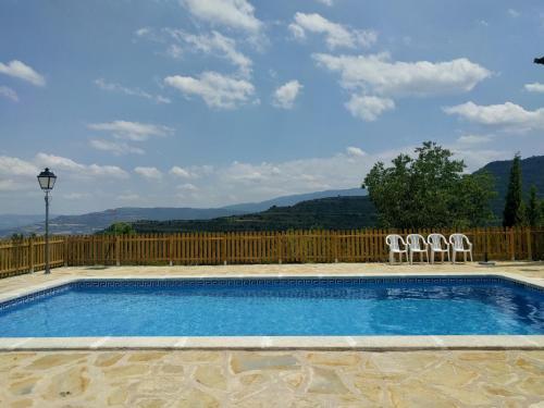 The swimming pool at or near Casa Miret de Mur