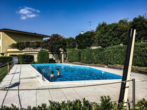 The swimming pool at or near Villa Maggie