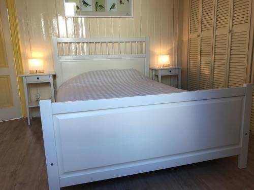 Een bed of bedden in een kamer bij Posthuisje Zandvoort