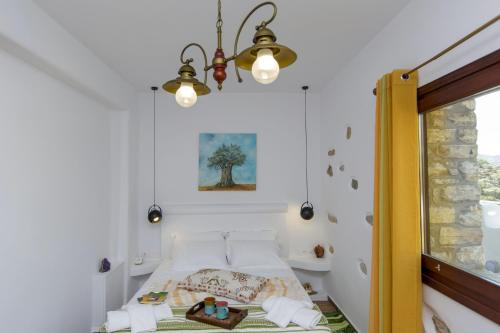 A bed or beds in a room at ELaiolithos Luxury Retreat in Naxos