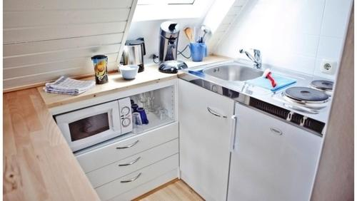 A kitchen or kitchenette at Picklapp Apartments