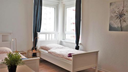 A bed or beds in a room at Apartment Furstenberger Strasse