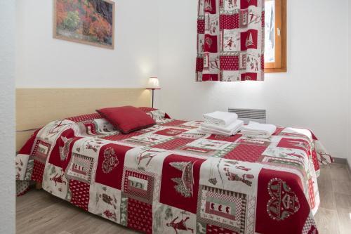 Un ou plusieurs lits dans un hébergement de l'établissement Résidence Odalys Les Lumières de Neige