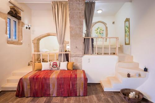 A bed or beds in a room at Casa Ermioni Stone House