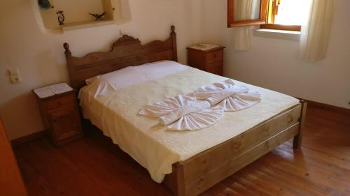 A bed or beds in a room at Patriko Traditional Stone Houses