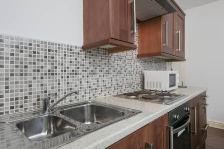 A kitchen or kitchenette at Midtown Apartments