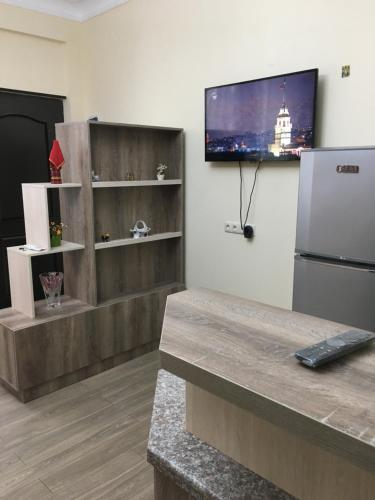 A television and/or entertainment center at Suite Gold Apartment
