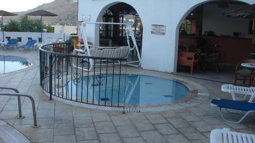 The swimming pool at or near Apostolis Hotel Apartments
