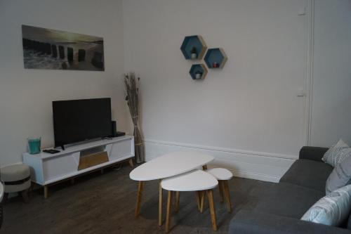 Télévision ou salle de divertissement dans l'établissement Nordic chic