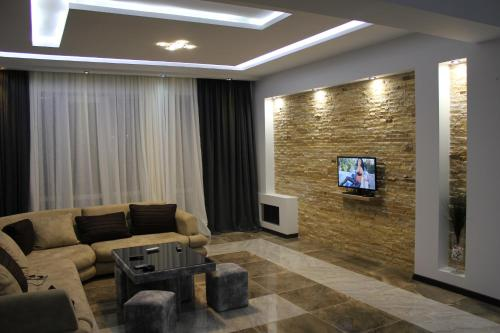 A television and/or entertainment center at Apartament SportPalace