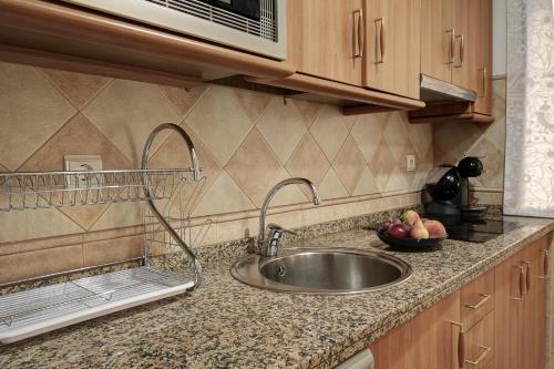 Una cocina o zona de cocina en ByC Apartamentos Realejo