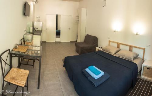 Een bed of bedden in een kamer bij Нouse by the river