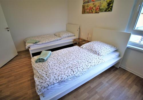 A bed or beds in a room at Apartments Potsdamer Strasse Dusseldorf