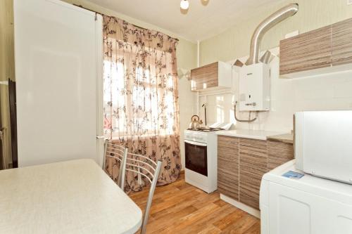 A kitchen or kitchenette at Apartment on Svobody street