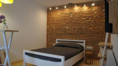 A bed or beds in a room at Bohemian Cozy place Cluj