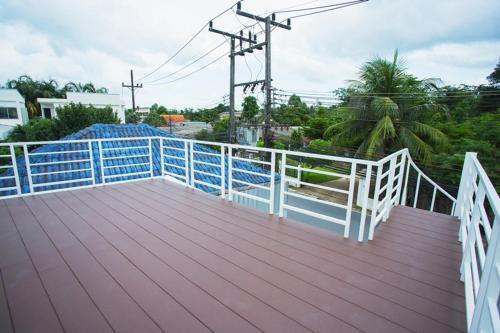 A balcony or terrace at Simply Green at Chalong