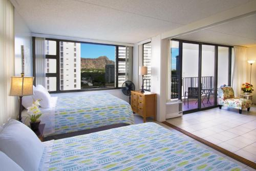 1 Bedroom Condo in the Waikiki Banyan | 1 Block from Beach | Parking & WiFi