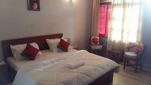 A bed or beds in a room at High View Cottage - Rishikesh