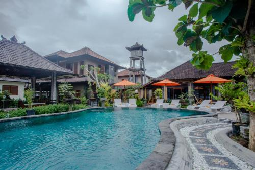 The swimming pool at or near Capung Cottages