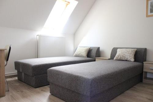 A bed or beds in a room at Rudolf Apartment